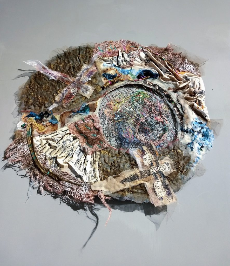 """Dreamcatcher: Wabi V"", 2020, 65 x 55 cm, hand-weaved net, hand embroidery on textile collage, felt, melted chiffon, found objects."